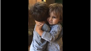 Precious little cousins can't stop hugging each other