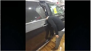 Car Salesman Gets Head Stuck While Demonstrating Door Feature  - Video