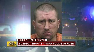 Tampa Police officer shot while serving warrant - Video