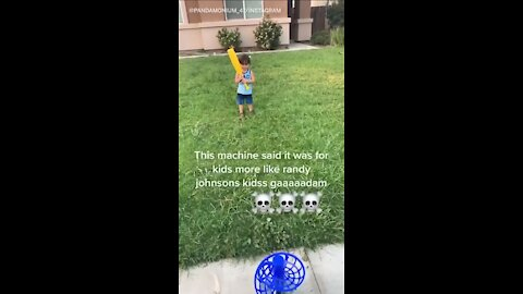 Pitching machine sends whiffle ball straight into kid's face