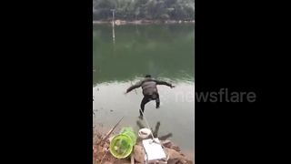 Fishing rod dragged away by hooked fish