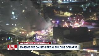 Massive fire causes downtown building to collapse inward - Video