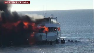 Video shows casino boat engulfed in flames while passengers jump into the chilly Gulf waters to escape - Video
