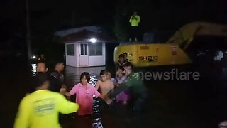Hundreds evacuated after high tide breaks embankment flooding homes in Thailand