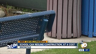 School can resume expansion project, at a cost