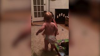 An Adorable Doggo Bites A Toddler's Diaper - Video