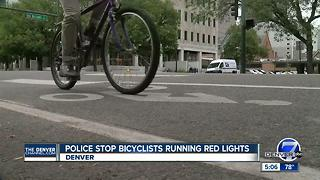 Police stop bicyclists running red lights in Denver - Video