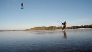 Mesmerizing footage shows daredevil kitesurfing across beautiful frozen lake