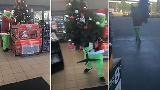 Half grinched: Prankster dressed as the Grinch steals christmas tree from petrol station