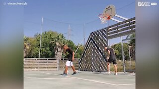 Youngster shoots hoop backwards using feet!