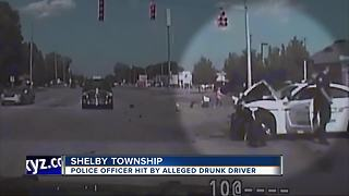 Shelby Twp. officer released from hospital after being hit by alleged drunk driver - Video