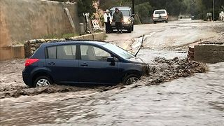 Car Swept Away in Santa Clarita Flood - Video