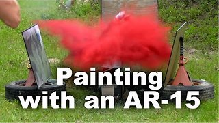 Man Creates Art Using AR-15 and Exploding Paint Cans - Video