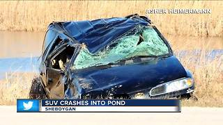 SUV crashes into pond in Sheboygan, driver ejected from vehicle - Video