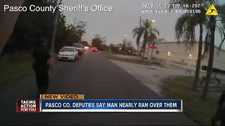 Pasco Co. Deputies say man nearly ran over them - Video