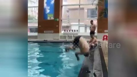 Man smacks his face on pool edge in very painful backflip fail