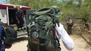 Fire crews rescue exhausted hiker - Video
