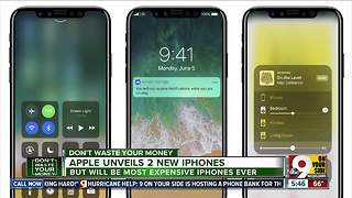 Apple unveils two new iPhones - Video