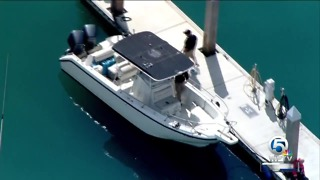 Customs checks out boat towed to shore in Fort Pierce - Video