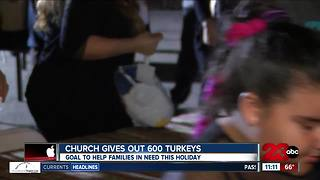 Local church gives out 600 turkeys - Video