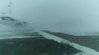 Car Freezes Over During the North Dakota Blizzard - Video