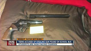 Teens accused of stealing gun found on school bus - Video