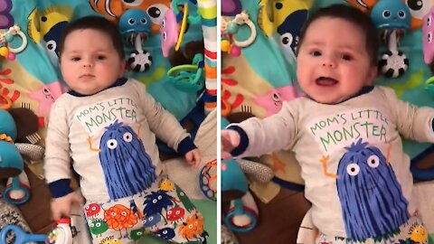 Baby adorably laughs during playtime with mommy
