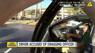 VIDEO: Body cam shows Florida officer being dragged by speeding car - Video