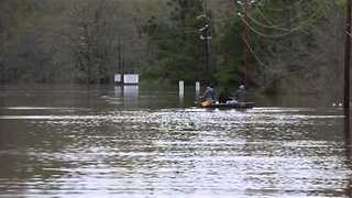 Men Fish on Flooded Louisiana Road - Video