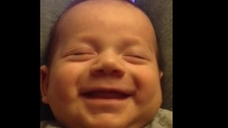 Baby boy preciously laughs in his sleep - Video