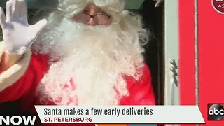 Santa Claus joins firefighters to give gifts to those in need - Video