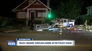 Truck crashes through two homes after leading police on chase across two towns - Video