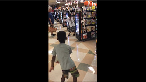 Little Boy Has Impromptu Dance-Off With Another Boy At Grocery Checkout