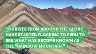Millions of Tourists Are Taking Their Next Trip to Peru's Mysterious Rainbow Mountain - Video