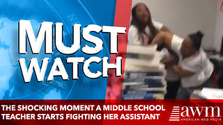The shocking moment a middle school teacher starts fighting her assistant - Video