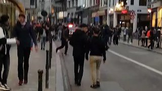 Social Media Star's Fans Stand on Car During Brussels Riot - Video