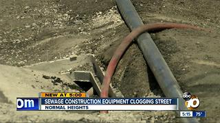 Sewage construction equipment clogging street - Video
