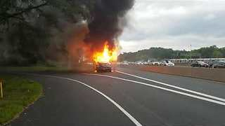 Bus Catches Fire on the Highway in Fairfax, Virginia - Video