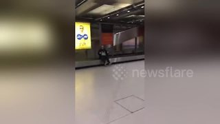 Drunk British woman rides airport conveyor belt - Video