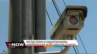 Red light tickets at clogged intersection - Video