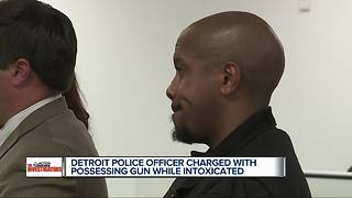 Detroit Police Officer charged with possessing firearm while intoxicated - Video