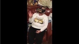 Mom can't handle VR roller coaster ride  - Video