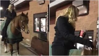 Lady takes her horse to a drive-thru
