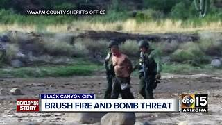 Man in custody after bomb threat, brush fire in Black Canyon City - Video