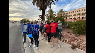 Around 100 people gather to protest Clark County School District sports decision