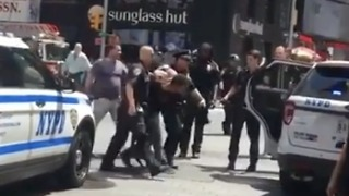 Police March Man to Vehicle Following Times Square Incident - Video
