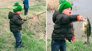 Little boy has precious reaction after catching a fish