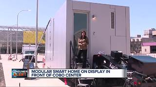Modular smart home on display in front of Cobo Center