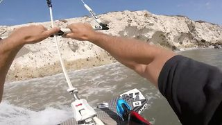 Kiteboarder performs amazing aerial tricks