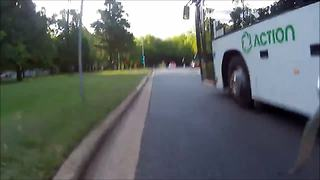 Reckless bus driver nearly crushes cyclist - Video